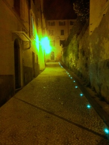 The street to our Apartment . I like the feel of the white pebbles under my feet, texture punctuated by a row little leds